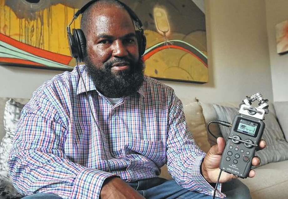 "Earlonne Woods shows recording equipment similar to what he used in San Quentin State Prison to produce his podcasts, during an interview in December in Oakland, California. Woods, 47, recently was released from San Quentin prison after California Gov. Jerry Brown commuted his 31-years-to-life sentence for attempted armed robbery. Brown cited Woods' leadership in helping other inmates and his work at ""Ear Hustle,"" a podcast he co-hosts and co-produces that documents everyday life inside the prison. ""Ear Hustle"" launched in 2017. Its roughly 30 episodes have been downloaded a total of 20 million times by fans all over the world. Photo: Ben Margot 