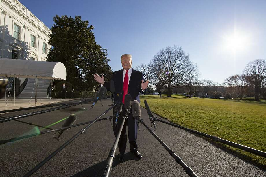 "President Trump speaks to reporters at the White House. Trump says he will not give an inch in his fight for funding a border barrier: ""There's not going to be any bend right here."" Photo: Alex Brandon / Associated Press"