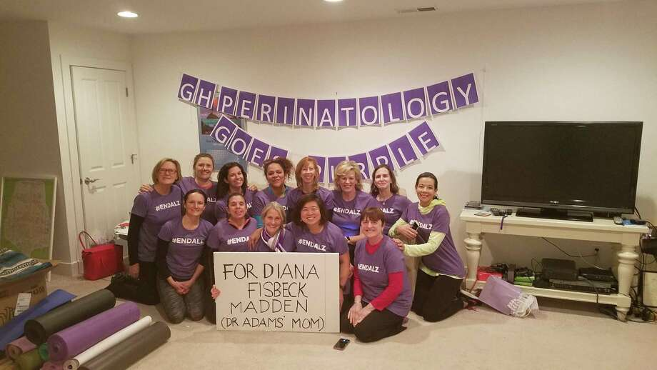 Members of the Greenwich Hospital's Perinatology Department wear purple #ENDALZ shirts in honor of Diana Fisbeck Madden, mother of Dr. Diana Adams, to raise awareness for Alzheimers disease. Purple is the official color of the national Alzheimer's Association. Photo: Contributed / /