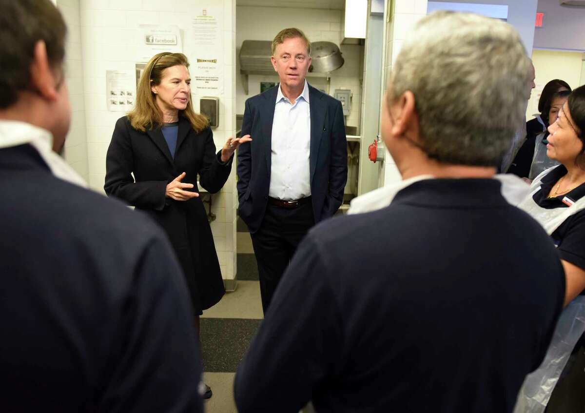 Lieutenant Governor-elect Susan Bysiewicz and Governor-elect Ned Lamont chat with members of the kitchen staff at the New Covenant Center soup kitchen in Stamford, Conn. Sunday, Jan. 6, 2019. Connecticut Governor-elect Ned Lamont and Lieutenant Governor-elect Susan Bysiewicz visited Catholic Charities of Fairfield County's New Covenant Center in Stamford on Sunday as part of the five-stop Day of Service throughout the state. Lamont chose the 40-year-old food insecurity program in Stamford to recognize the organization for providing more than 600,000 meals each year through its 365-day-a-year soup kitchen and three-day-a-week food pantry.