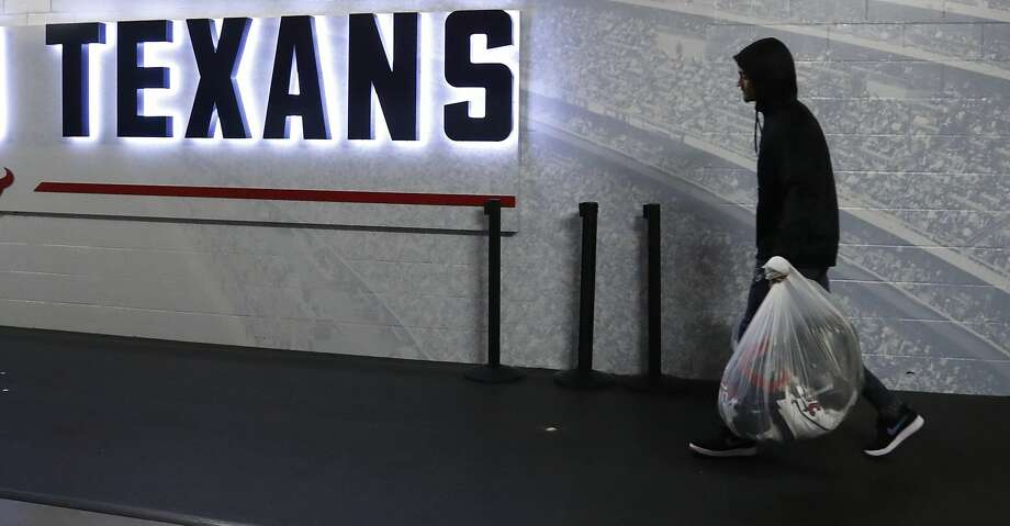 PHOTOS: Texans vs. Colts Houston Texans Kevin Johnson leaves the Texans locker room with the contents of his locker in plastic bags at NRG Stadium, Sunday, Jan. 6, 2019, in Houston. Browse through the photos to see action from the Texans' playoff loss to the Colts on Saturday. Photo: Karen Warren/Staff Photographer