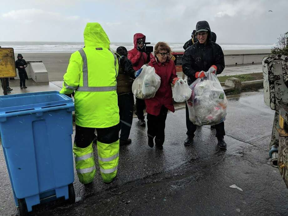 Reps. Jackie Speier, D-Hillsborough (middle to right) and Jared Huffman, D-San Rafael clean up trash at San Francisco beaches on Jan. 5, 2019. Photo: SFDOG
