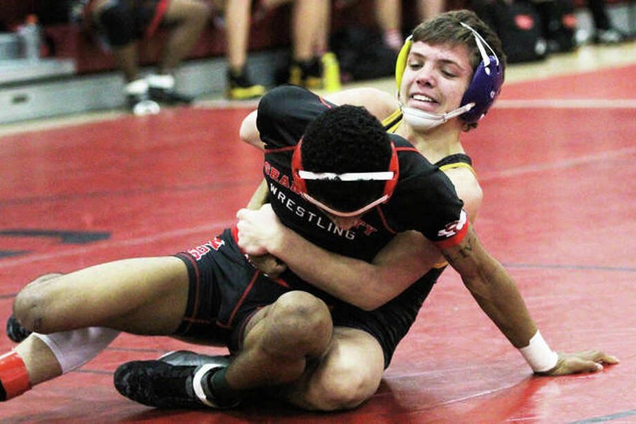 Civic Memorial sophomore Caleb Tyus (back) controls his Granite City opponent during a Dec. 20 dual in Granite City. On Saturday, Tyus improved his record to 21-1 with the 120-pound title at the Murdale Tourney in Carbondale. Photo: Greg Shashack / The Telegraph