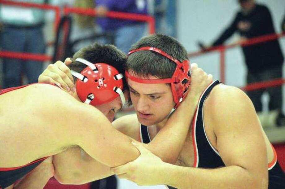 Edwardsville senior Josh Anderson (right) wrestles Hunter Tennison from Ozark (Mo.) on Nov. 30 during the Ron Sauer Duals at Fox High School in Arnold, Mo. Anderson won the 220-pound championship Saturday at the Cheesehead Invite in Wisconsin. Photo: Scott Marion / Hearst Illinois