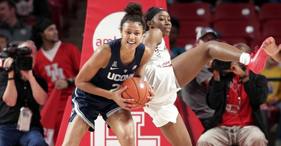 Connecticut forward Olivia Nelson-Ododa, left, gets the rebound in front of Houston guard Serithia Hawkins, right, during the second half of an NCAA college basketball game Sunday, Jan. 6, 2019, in Houston. (AP Photo/Michael Wyke) Photo: Michael Wyke/Associated Press