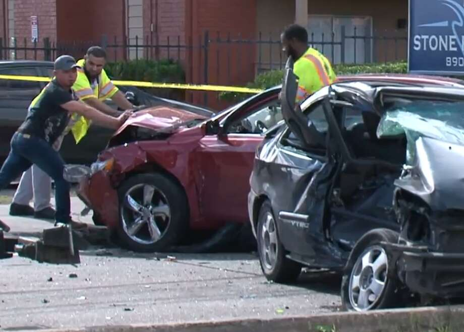 One person died just before 10 a.m. Sunday when a red Camry and a black Honda Civic crashed in the 8900 block of Bissonnet. Photo: Metro Video