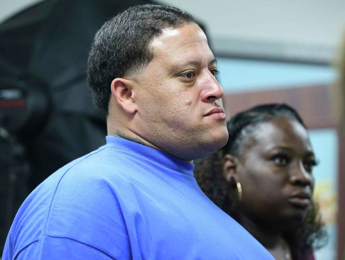 Christopher Cevilla, father of Jazmine Barnes, listens to Harris County Sheriff Ed Gonzalez giving updates on his daughter's homicide investigation during a press conference on Sunday, Jan. 6, 2019, in Houston. Eric Black Jr., 20, is charged with capital murder as one of the individuals who are responsible for the death of Jazmine, 7.