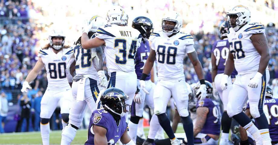 BALTIMORE, MARYLAND - JANUARY 06: Melvin Gordon #28 of the Los Angeles Chargers celebrates with Derek Watt #34 after scoring a one yard touchdown against the Baltimore Ravens during the fourth quarter in the AFC Wild Card Playoff game at M&T Bank Stadium on January 06, 2019 in Baltimore, Maryland. (Photo by Patrick Smith/Getty Images) Photo: Patrick Smith/Getty Images