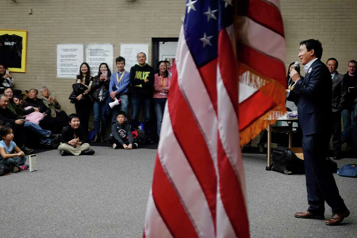 Democratic presidential candidate Andrew Yang, right, addresses those gathered at Shaker Junior High School on Sunday, Jan. 6, 2019, in Latham, N.Y. (Paul Buckowski/Times Union)
