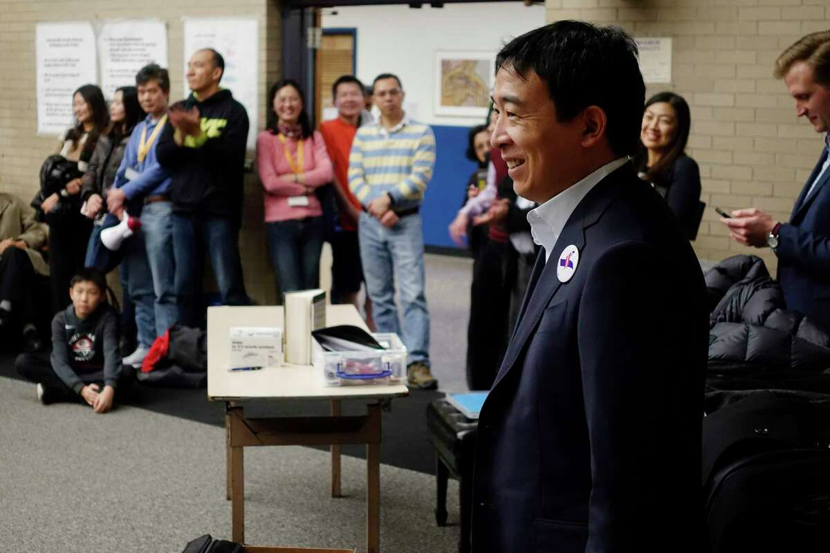 Democratic presidential candidate Andrew Yang listens as he is introduced to speak at Shaker Junior High School on Sunday, Jan. 6, 2019, in Latham, N.Y. Yang was born in Schenectady. (Paul Buckowski/Times Union)