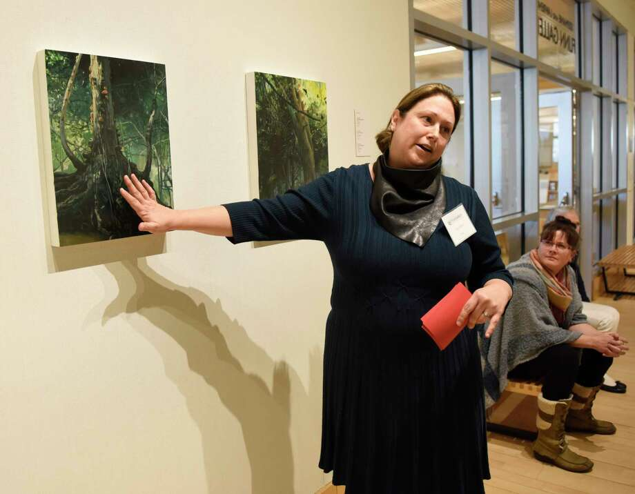 """Artist Amy Talluto speaks about her work on display in the """"Forces of Nature"""" exhibition at Greenwich Library's Flinn Gallery in Greenwich, Conn. Sunday, Jan. 6, 2019. The exhibition, which runs through January 23, shows how the beauty and wonder of nature provides endless visual influences and opens possibilities for art making. Work by artists Amy Talluto, Rebecca Hutchinson and Elena Lyakir is on display. Photo: Tyler Sizemore, Hearst Connecticut Media / Greenwich Time"""