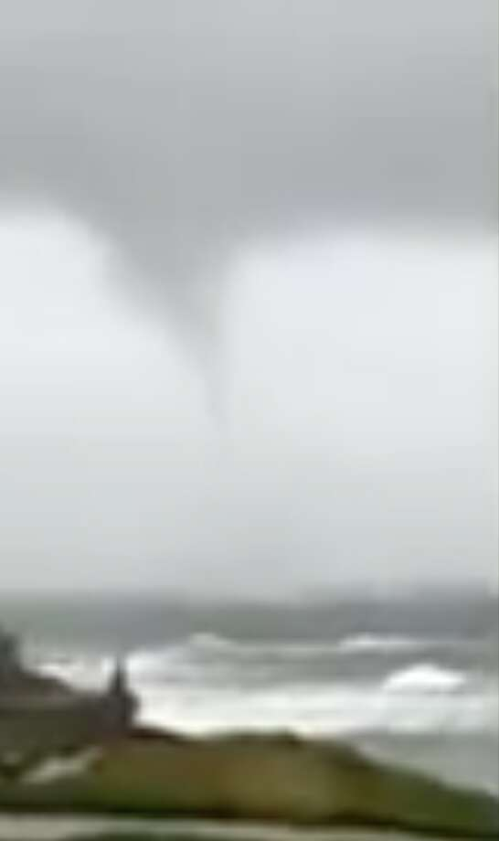Screengrab from a video shared by NWS Bay Area on Sunday, January 6, 2019 of a waterspout spotted near Santa Cruz. Photo: By DropAndTurnShow Via NWS Bay Area