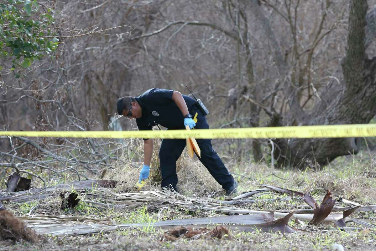 A San Antonio Police crime scene investigator collects evidence from an area along Leon Creek by Rodriguez County Park after finding evidence pertaining to missing eight-month-old King Jay Davila, Sunday, Jan. 6, 2019. The child went missing after being abducted from a nearby convenient store on Friday. A group of family and friends searching the area found a baby bottle that the mother of the child said belong to Davila.