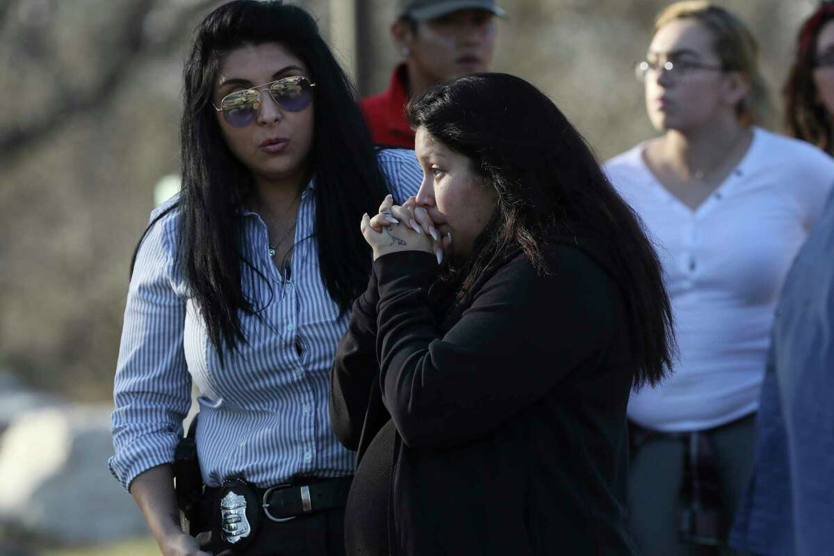 Jasmine Gonzales, mother of missing eight-month-old King Jay Davila, talks with a San Antonio Police investigator by an area along Leon Creek by Rodriguez County Park, Sunday, Jan. 6, 2018. The child went missing after being abducted from a nearby convenient store on Friday. A group of family and friends searching the area found a baby bottle that she said belong to her son. Soon after taking with the investigator, Gonzales left the scene.