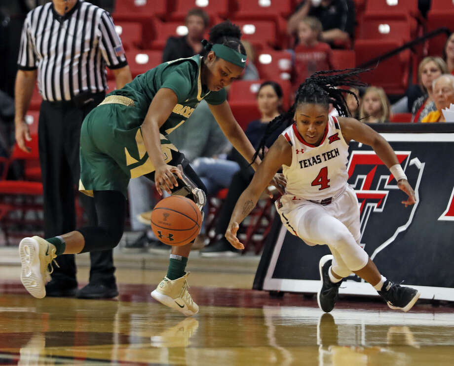 Texas Tech freshman point guard Chrislyn Carr (right) tries to steal the ball away from a Baylor player during Big 12 women's basketball action on Sunday at United Supermarkets Arena in Lubbock. Photo: Brad Tollefson/Lubbock Avalanche-Journal
