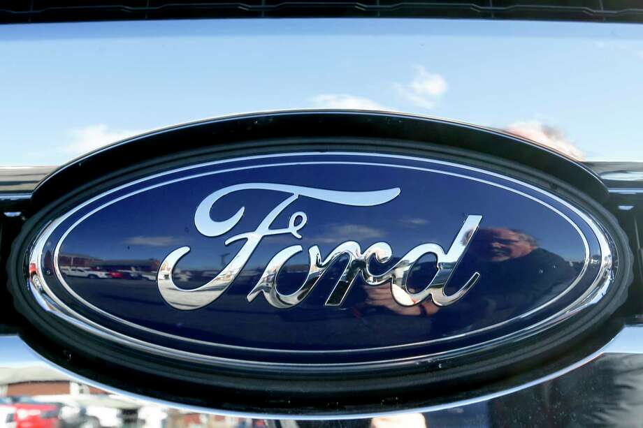 FILE - This Nov. 19, 2015 file photo shows the blue Ford oval badge in the grill of a pickup truck on the sales lot at Butler County Ford in Butler, Pa.  On Friday, Jan. 4, 2019, Ford is recalling more than 953,000 vehicles worldwide to replace Takata passenger air bag inflators that can explode and hurl shrapnel. The move includes 782,000 vehicles in the U.S. and is part of the largest series of recalls in U.S. history.(AP Photo/Keith Srakocic, File) Photo: Keith Srakocic / Copyright 2019 The Associated Press. All rights reserved.