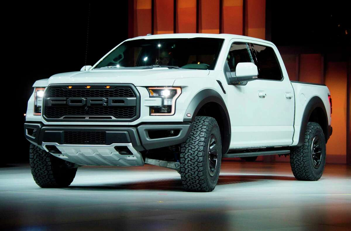 (FILES) In this file photo taken on January 11, 2016, the Ford F-150 Raptor is unveiled during the Ford press conference at the North American International Auto Show in Detroit. - Ford is recalling 874,000 of its best-selling F-series pickup trucks due to fire risk from the engine block heater system, the company announced on December 21, 2018. (Photo by JIM WATSON / AFP)JIM WATSON/AFP/Getty Images