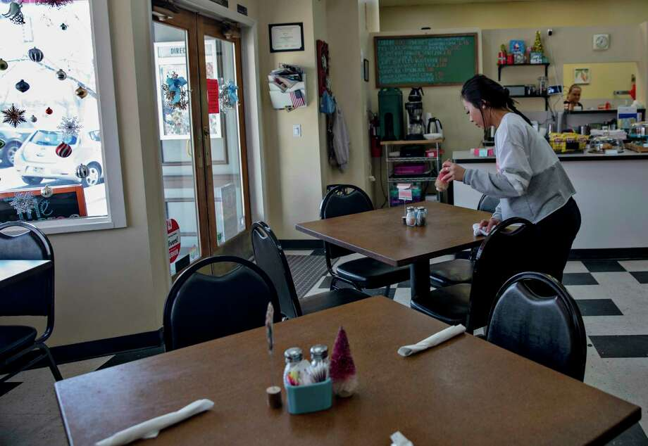 Irish Sumo, a waitress at Bickering Sisters, wipes down a table in the restaurant in Ogden, Utah, on Friday, Jan. 4, 2019. The normally bustling lunch spot is open fewer hours because of the partial federal government shutdown. Photo: Photo For The Washington Post By Kim Raff. / Kim Raff