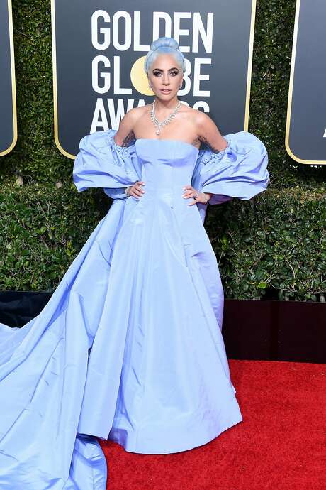 """A Star is Born"" diva Lady Gaga wears periwinkle in homage to her film foremother, Judy Garland. Photo: Jon Kopaloff / Getty Images"
