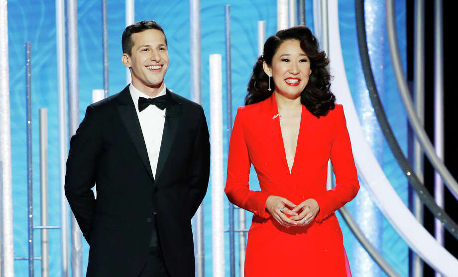 In this handout photo provided by NBCUniversal, Hosts Andy Samberg and Sandra Oh speak onstage during the 76th Annual Golden Globe Awards at The Beverly Hilton Hotel on January 06, 2019 in Beverly Hills. Photo: (Photo By Paul Drinkwater/NBCUniversal Via Getty Images) / 2019 NBCUniversal Media, LLC