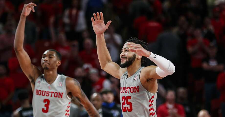 Houston guards Armoni Brooks (3) and Galen Robinson Jr. (25) celebrate the Cougars 90-77 win over Memphis in an NCAA basketball game at Fertitta Center on Sunday, Jan. 6, 2019, in Houston. Photo: Brett Coomer/Staff Photographer