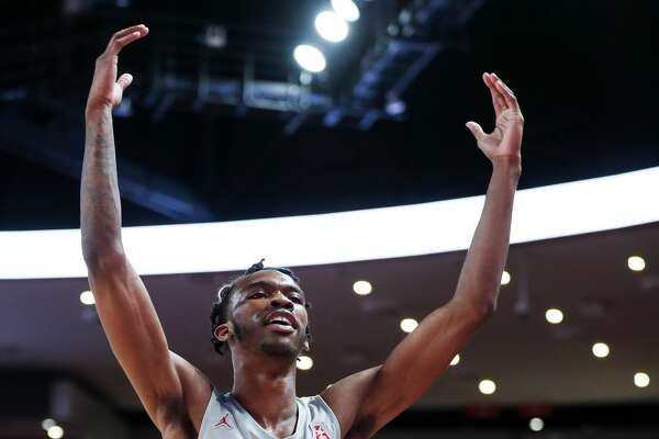 Houston guard Dejon Jarreau (13) celebrates the Cougars 90-77 win over Memphis in an NCAA basketball game at Fertitta Center on Sunday, Jan. 6, 2019, in Houston.