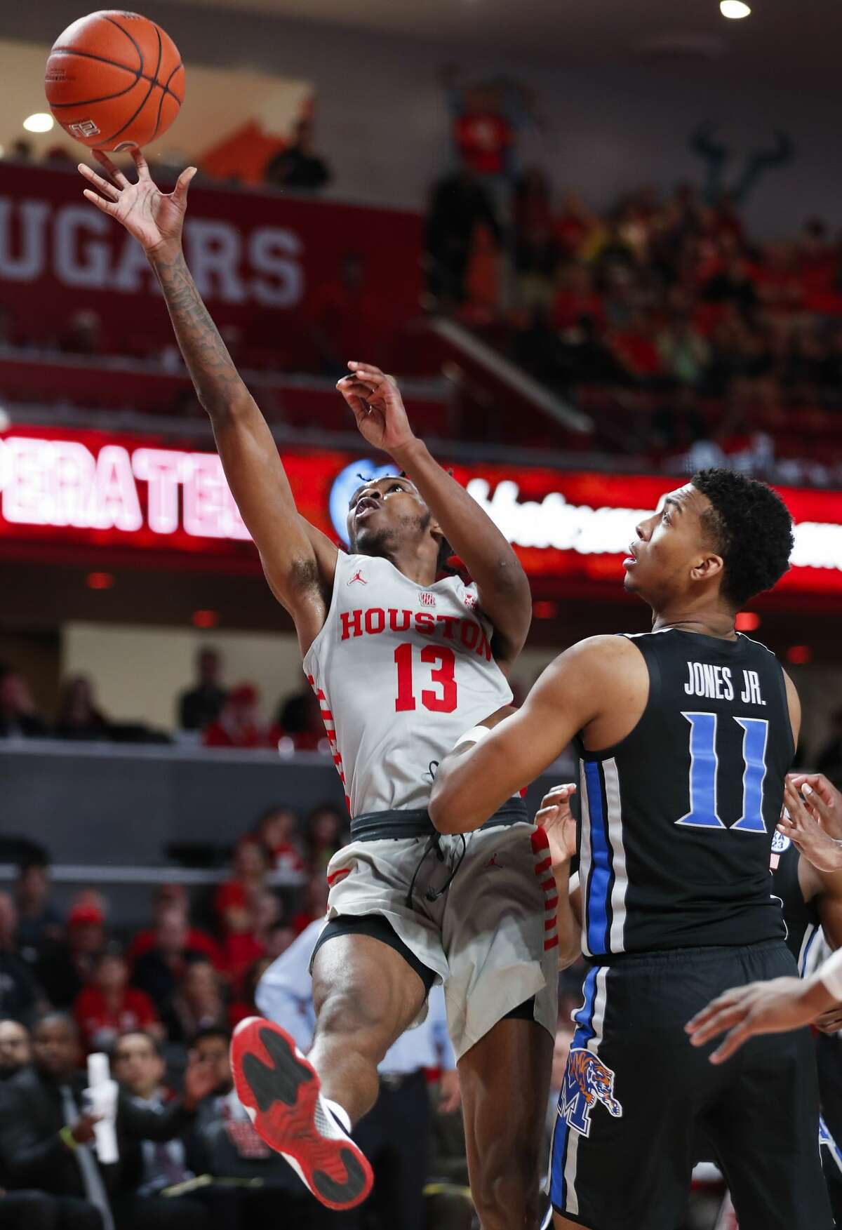 Houston guard Dejon Jarreau (13) takes a shot against Memphis guard Antwann Jones (11) during the second half on a NCAA basketball game at Fertitta Center on Sunday, Jan. 6, 2019, in Houston.