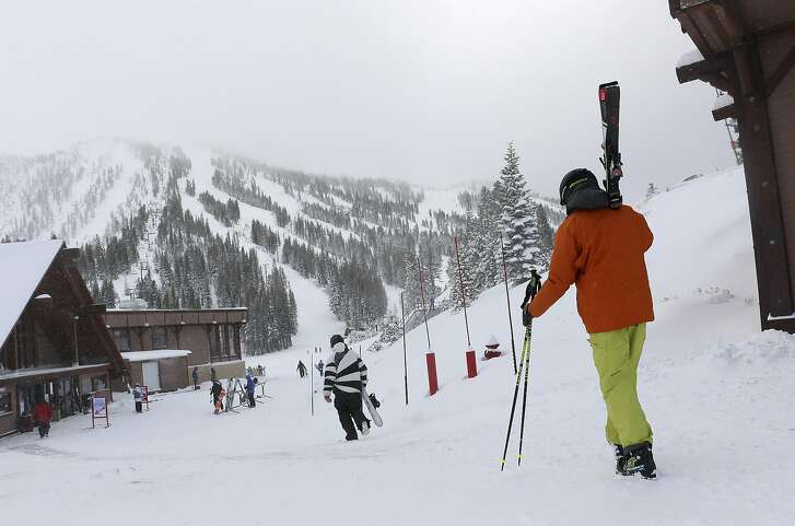FILE - In this Nov. 29, 2018, file photo, skiers and snowboarders walk to the lifts at Mt. Rose Ski Tahoe near Reno, Nev. Avalanche warnings have been posted in parts of California, Nevada and Utah after a winter storm dumped heavy snow on the region. The Sierra Avalanche Center issued a backcountry avalanche warning for the Lake Tahoe area stretching south into the Sierra along the California-Nevada line from noon Sunday, Jan. 6, 2018, until 7 a.m. (Jason Bean/The Reno Gazette-Journal via AP, File)