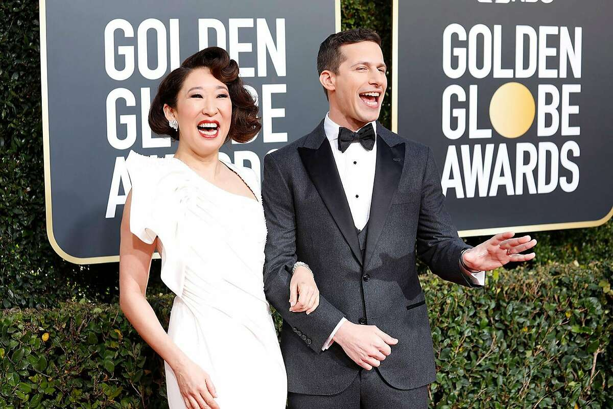 Sandra Oh and Andy Samberg arrive at the 76th Annual Golden Globes at the Beverly Hilton Hotel in Beverly Hills, Calif., on Sunday, Jan. 6, 2019.