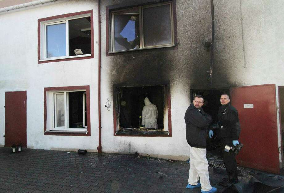 """Forensic and other police experts examine the site of a fire in an Escape Room, in Koszalin, northern Poland, on Saturday, Jan. 5, 2019. Investigators in Poland on Saturday blamed a gas leak in a heating system at an """"Escape Room"""" for a fire that killed five teenage girls and injured a man. (AP Photo) / Copyright 2019 The Associated Press. All rights reserved."""