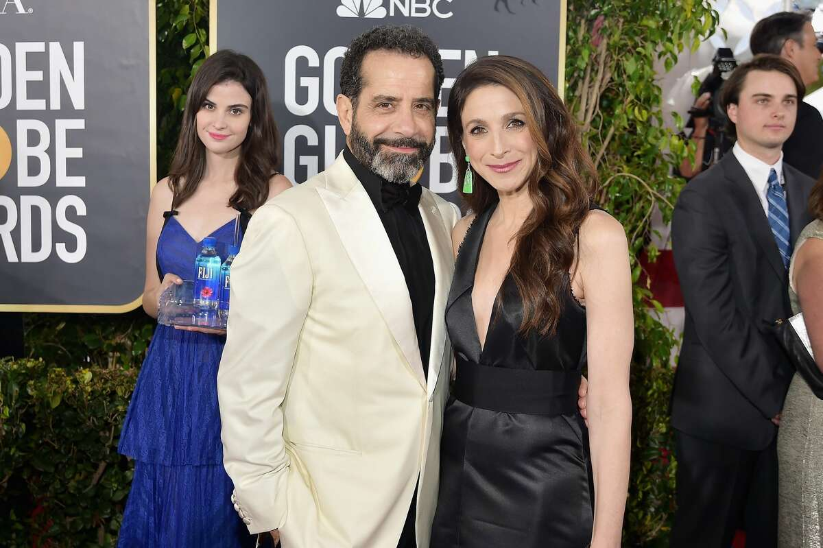 """(L-R) Tony Shalhoub and Marin Hinkle attend FIJI Water at the 76th Annual Golden Globe Awards on January 6, 2019 at the Beverly Hilton in Los Angeles.Model Kelleth Cuthbert was later identified as the so-called """"Fiji Water Girl.""""(Photo by Stefanie Keenan/Getty Images for FIJI Water)"""