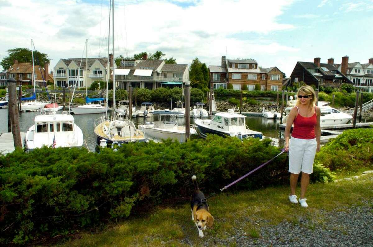 Dolphin Cove resident Marian Nissen walks her beagle