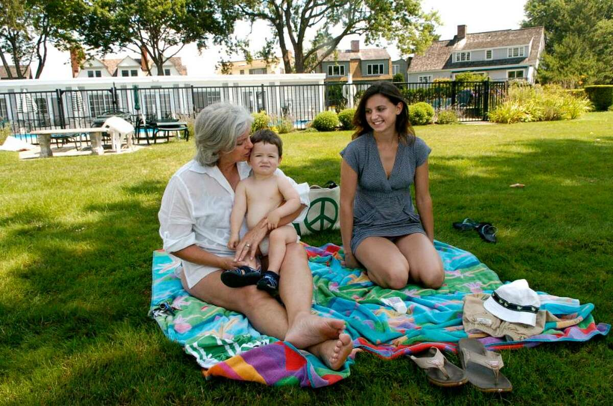 Patti Meyer, her grandson Grayson and daughter Lauren enjoy the weather at the Dolphin Cove Club, a private club for Dolphi Cove residents, in Stamford, Conn. on Tuesday July 20, 2010.