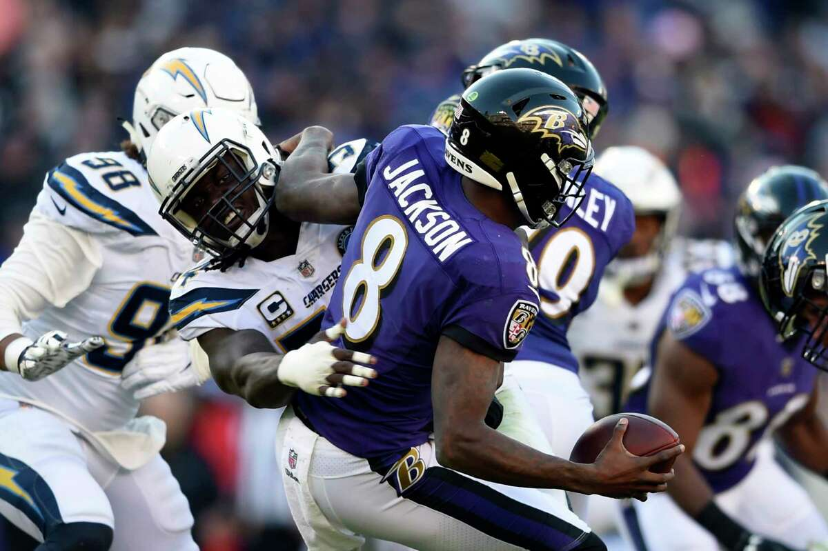 Baltimore Ravens quarterback Lamar Jackson (8) is sacked by Los Angeles Chargers defensive end Melvin Ingram in the second half of an NFL wild card playoff football game, Sunday, Jan. 6, 2019, in Baltimore. (AP Photo/Gail Burton)