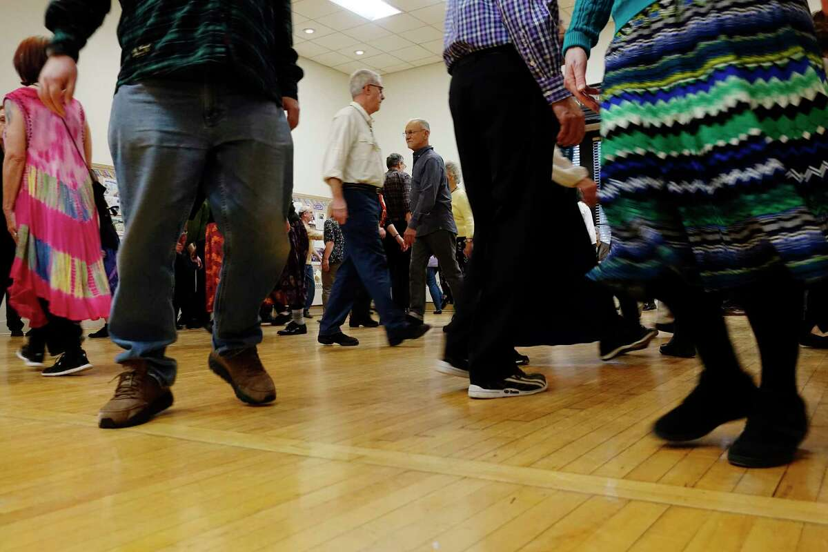 People taking part in the first Sunday dance event, sponsored by the Capital English Country Dancers, at the First Unitarian Universalist Society of Albany, move across the dance floor on Sunday, Jan. 6, 2019, in Albany, N.Y. The dance events take place the first Sunday of the month from October through May. Nancy Yule, the founder of the event, said that the music and the dance in English country dance are closely connected but that should not scare anyone from coming to try the dance.
