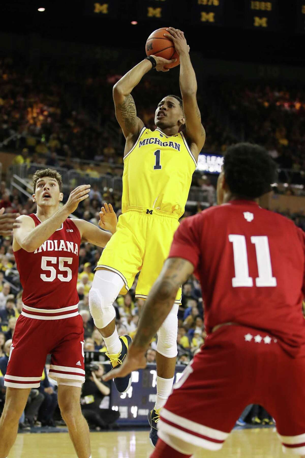 ANN ARBOR, MICHIGAN - JANUARY 06: Charles Matthews #1 of the Michigan Wolverines takes a jump shot next to Evan Fitzner #55 of the Indiana Hoosiers during the first half at Crisler Arena on January 06, 2019 in Ann Arbor, Michigan. (Photo by Gregory Shamus/Getty Images)