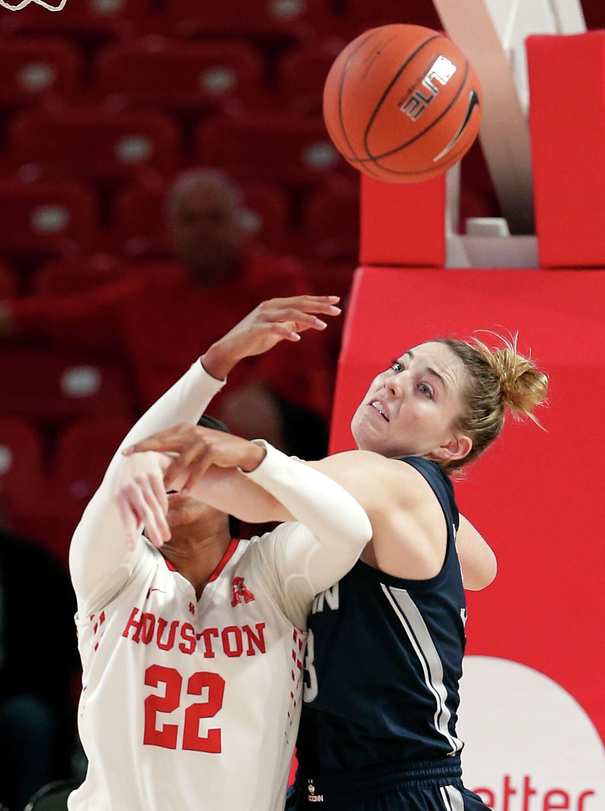 Houston forward Myyah West (22) has her shot-attempt knocked away by Connecticut guard/forward Katie Lou Samuelson (33) during the first half of an NCAA college basketball game Sunday, Jan. 6, 2019, in Houston. (AP Photo/Michael Wyke)