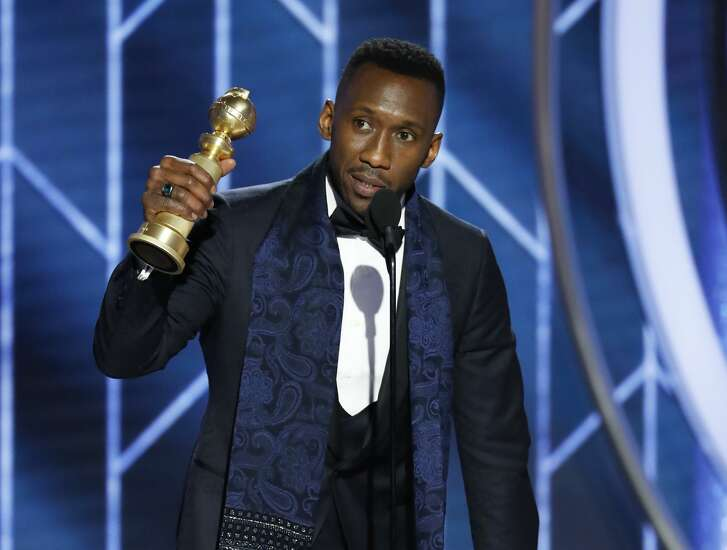 "Mahershala Ali accepts the award for best supporting actor in a motion picture for his role in ""Green Book."""