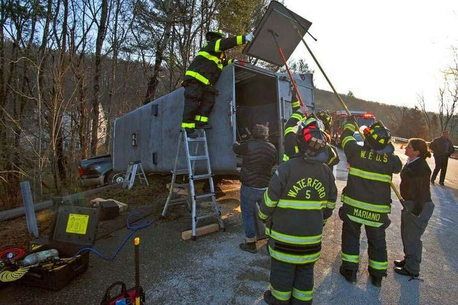 Two horses were saved from a overturned trailer perched over an embankment on the Interstate 395 - Route 32 connector in Waterford on Sunday, Jan. 6, 2019. Firefighters and veterinarians worked to free the horses. It took up to 90 minutes to free the horses. Photo: Cohanzie Fire Company Photo