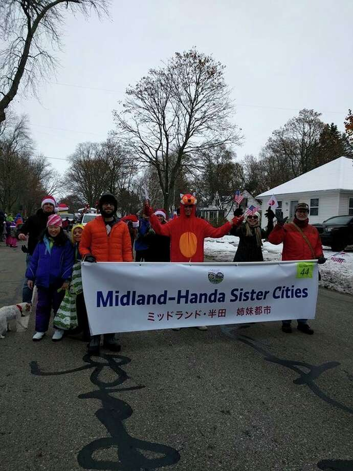 Members of the Midland-Handa Sister City committee march in Midland's Santa Parade on Nov. 27, 2018. (Photo courtesy of John Metcalf)