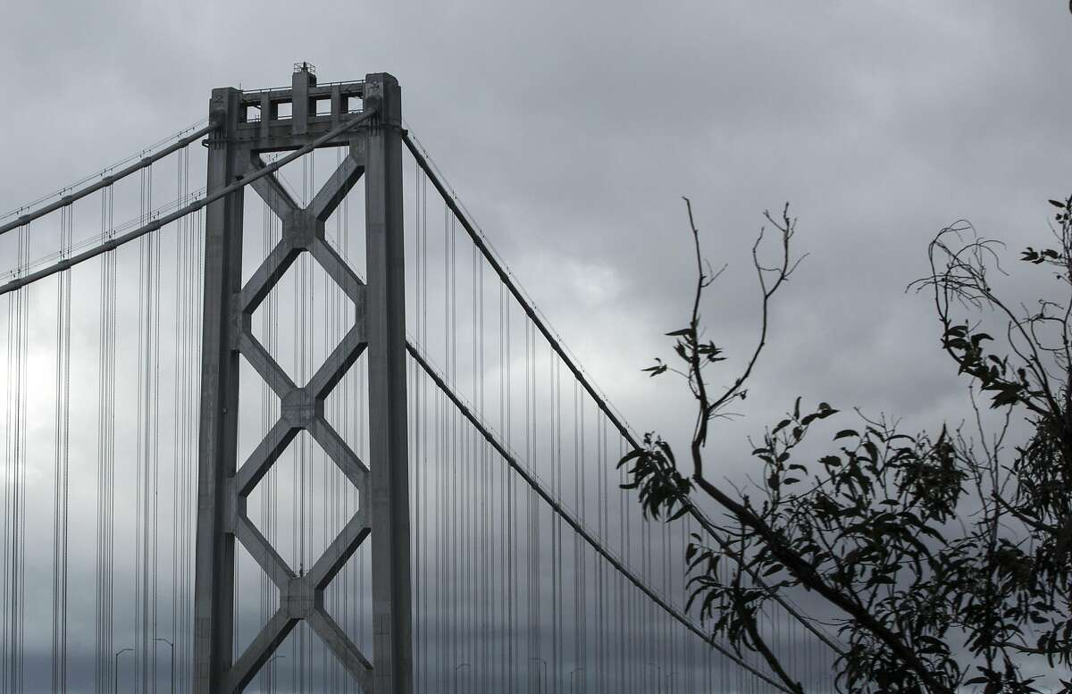 Dark clouds hang over the Bay Bridge in San Francisco, Calif. Saturday, Jan. 5, 2019 as a winter storm moves through the Bay Area.