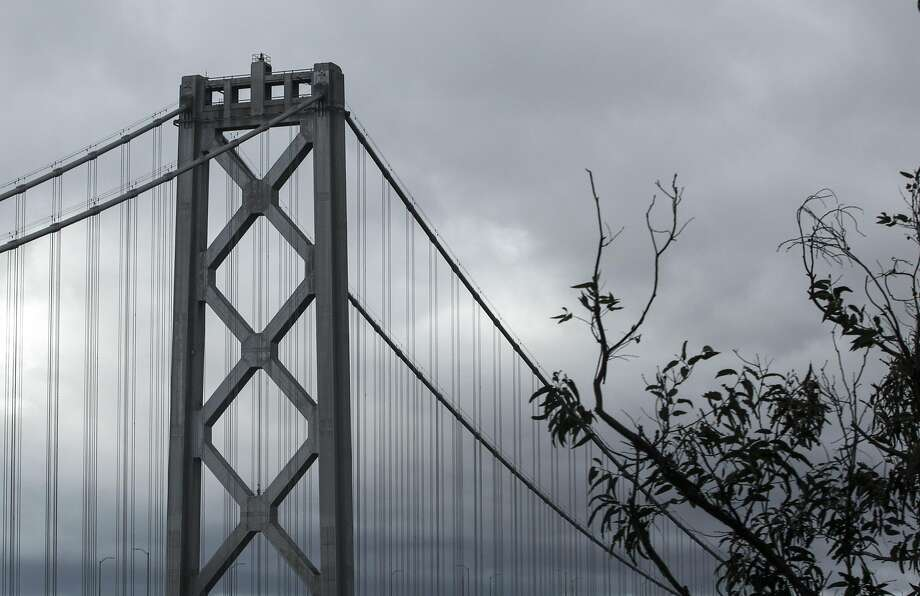 Dark clouds hang over the Bay Bridge in San Francisco, Calif. Saturday, Jan. 5, 2019 as a winter storm moves through the Bay Area. Photo: Jessica Christian / The Chronicle