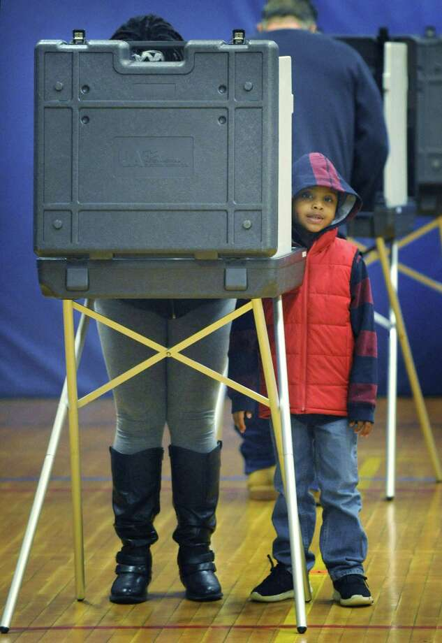 Voters including Jasmine Rodriguez with her son Dominic, 5, cast their ballots at Marvin Elementary School on Tuesday, November 6, 2018, in Norwalk, Conn. Photo: Erik Trautmann / Hearst Connecticut Media / Norwalk Hour
