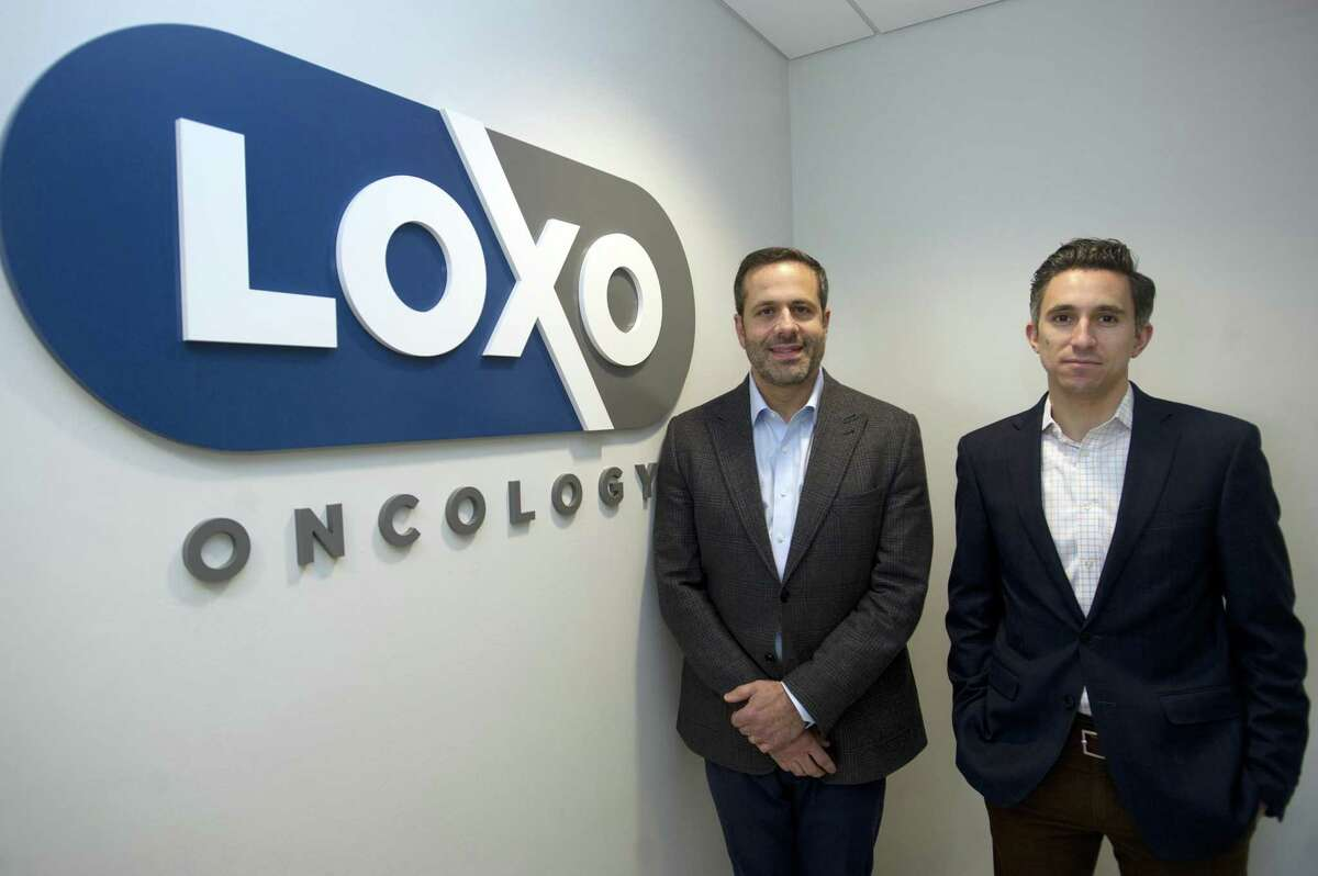 Loxo Oncology president and Chief Executive Officer Dr. Joshua Bilenker, left, and Chief Business Officer Jacob Van Naarden pose for a photo inside the company's headquarters on Tresser Blvd. in downtown Stamford, Conn. on Wednesday, Oct. 24, 2018.