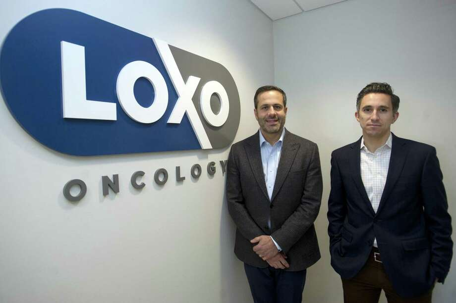 Loxo Oncology president and Chief Executive Officer Dr. Joshua Bilenker, left, and Chief Business Officer Jacob Van Naarden pose for a photo inside the company's headquarters on Tresser Blvd. in downtown Stamford, Conn. on Wednesday, Oct. 24, 2018. Photo: Michael Cummo / Hearst Connecticut Media / Stamford Advocate
