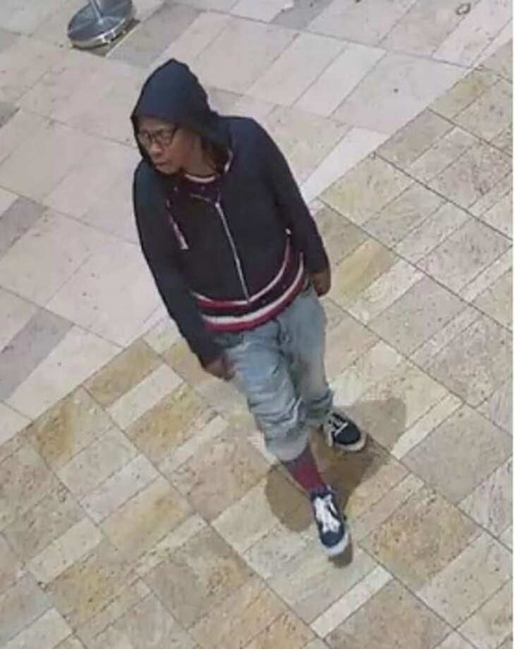 """Milford Police are looking for this suspect — described as a black female, 5'5"""", 180 lbs, 20-30 years old with dreadlocks and glasses — in connection to an Oct. 31, 2018 robbery at the CT Post Mall. Photo: Milford Police"""