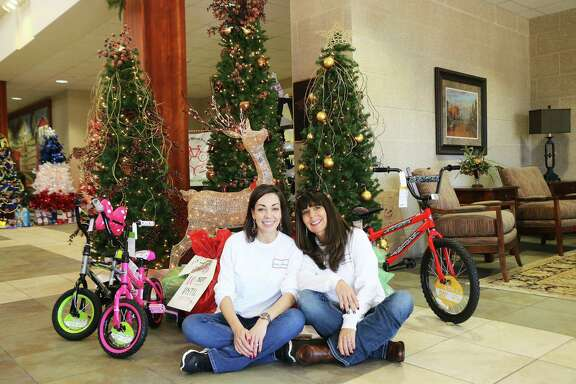 Teresa McCrory (Cassie's mom) helped her daughter Cassie Milam keep things organized for the annual Liberty County Bikes for Christmas event.