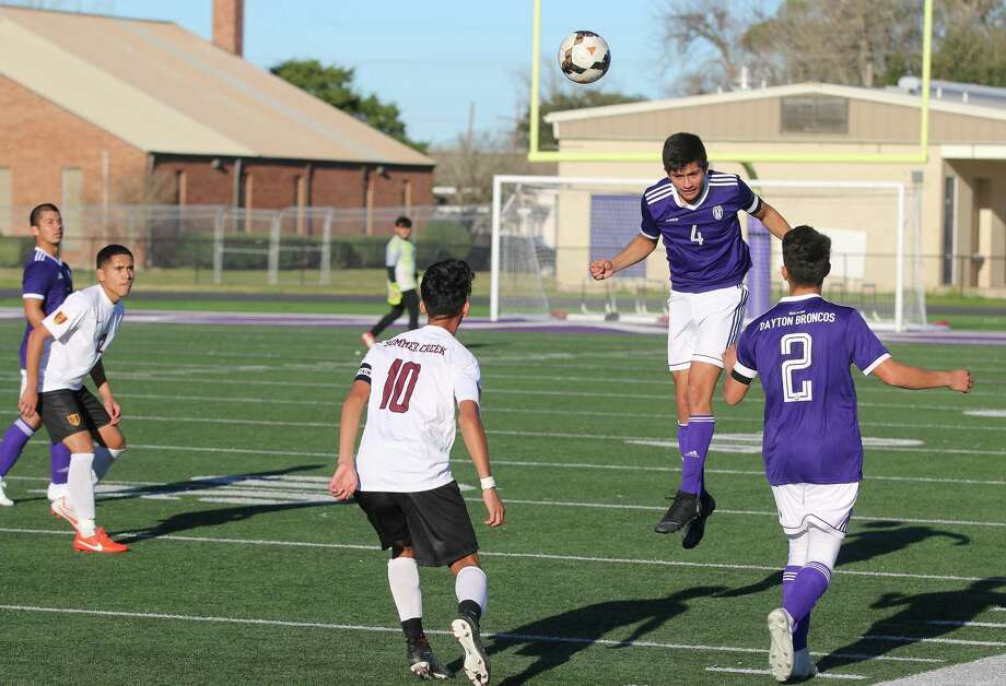 Dayton's Juan Medrano dinks the ball with his head in the Bronco's non-district matchup with Summer Creek Friday at Bronco Stadium. Dayton won the game, 4-1. Photo: David Taylor / HCN