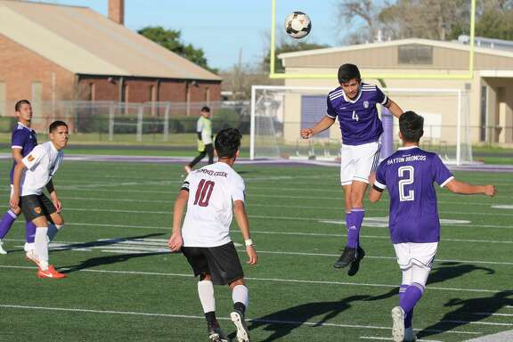 Dayton's Juan Medrano dinks the ball with his head in the Bronco's non-district matchup with Summer Creek Friday at Bronco Stadium. Dayton won the game, 4-1.