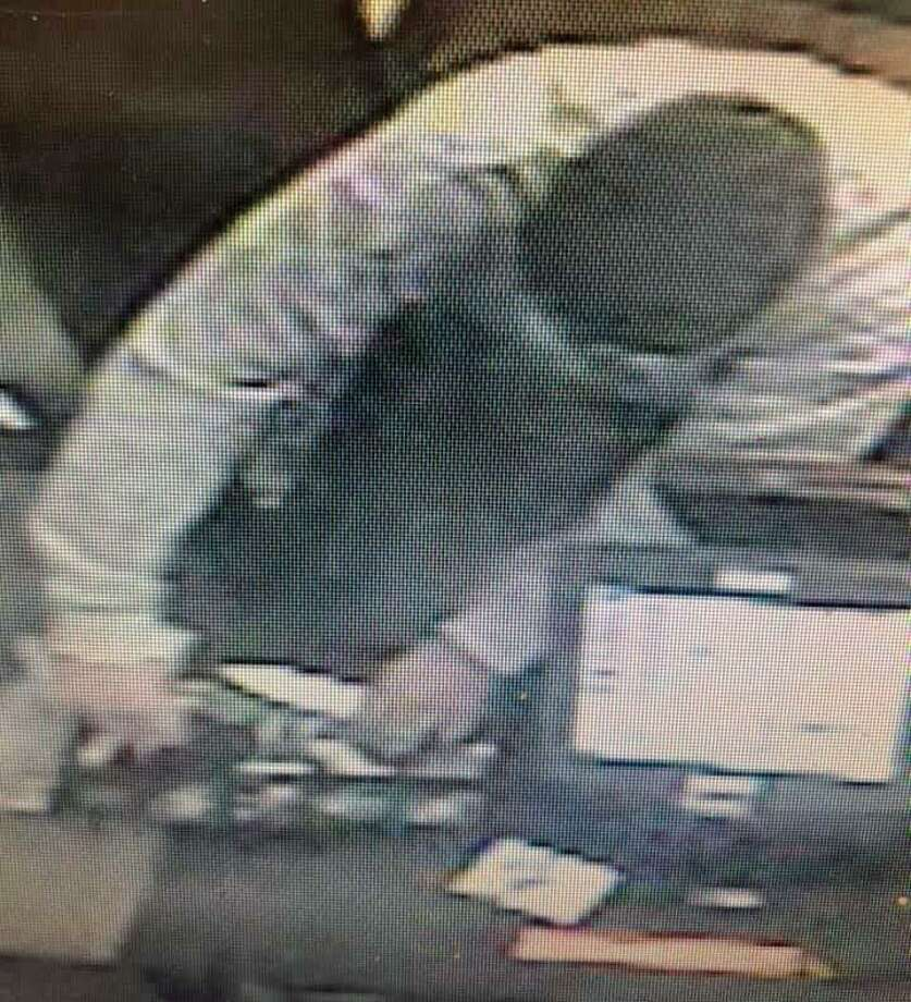 Police are seeking the public's help to ID a suspect in an armed robbed at Dunkin' Donuts on Roosevelt Drrive on Jan. 1, 2019. Seymour detectives said the robbery happened about 12:30 p.m. The masked suspect, who had a knife, demanded money and fled on foot toward a parked SUV-type vehicle on Route 34. Photo: Seymour Police Department Photo